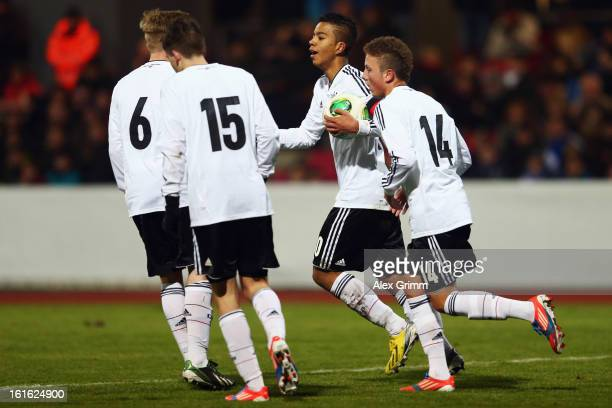 Benjamin Henrichs of Germany celebrates his team's fourth goal with team mates during the U16 international friendly match between Germany and...