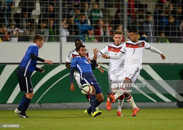 Benjamin Henrichs of Germany challenges Amergy Pineda of team USA during the U19 MercedesBenz Elite Cup at Gazi Stadion on October 6 2015 in...