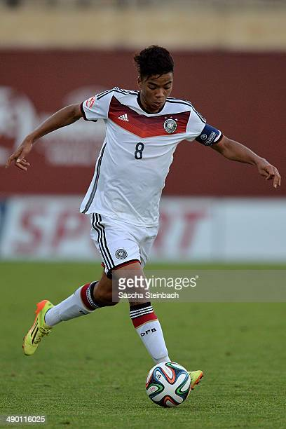 Benjamin Henrichs of Germany runs with the ball during the UEFA Under17 European Championship 2014 group B match between Germany and Scotland at...