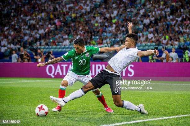 Benjamin Henrichs of Germany tackles Javier Aquino of Mexico during FIFA Confederations Cup Russia semifinal match between Germany and Mexico at...