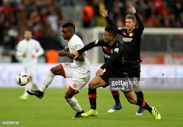 Benjamin Henrichs of Leverkusen and Copete Cordoba of Mainz battle for the ball during the Bundesliga match between Bayer 04 Leverkusen and 1 FSV...