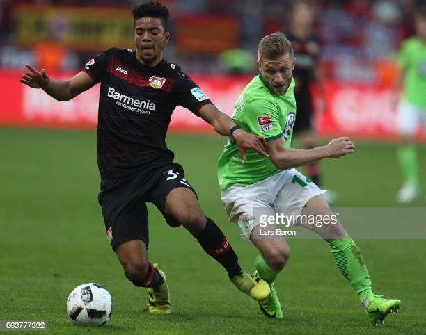 Benjamin Henrichs of Leverkusen is challenged by Jakub Blaszczykowski of Wolfsburg during the Bundesliga match between Bayer 04 Leverkusen and VfL...