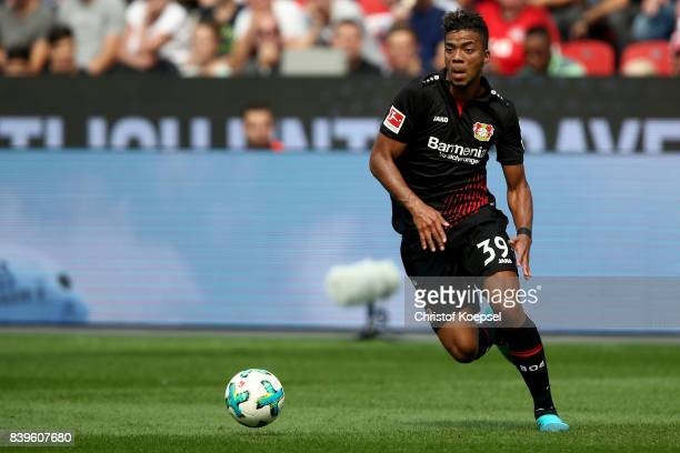 Benjamin Henrichs of Leverkusen runs with the ball during the Bundesliga match between Bayer 04 Leverkusen and TSG 1899 Hoffenheim at BayArena on...
