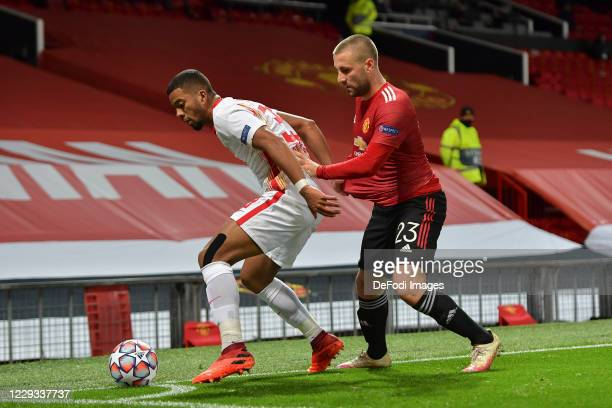 Benjamin Henrichs of RB Leipzig and Luke Shaw of Manchester United battle for the ball during the UEFA Champions League Group H stage match between...