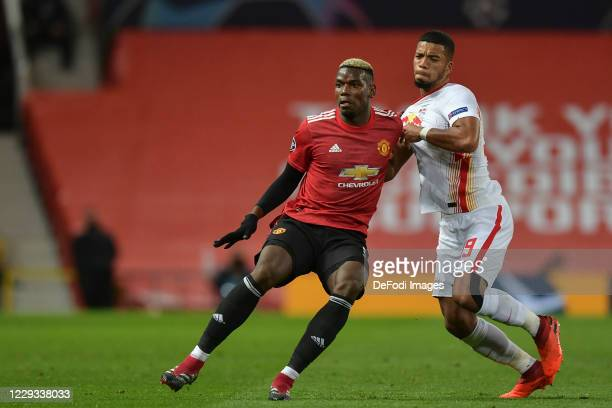 Benjamin Henrichs of RB Leipzig and Paul Pogba of Manchester United battle for the ball during the UEFA Champions League Group H stage match between...