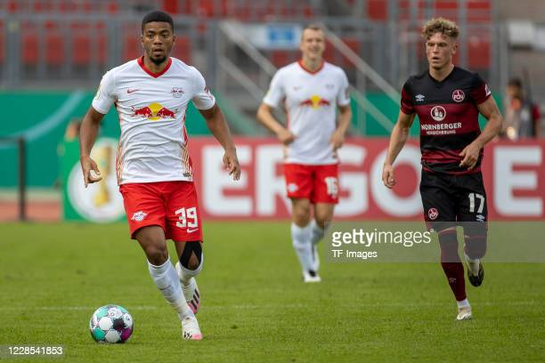 Benjamin Henrichs of RB Leipzig and Robin Hack of 1FC Nuernberg during the DFB Cup first round match between 1 FC Nuernberg and RB Leipzig at...