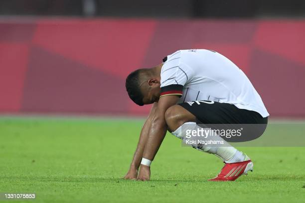 Benjamin Henrichs of Team Germany looks dejected following the Men's Group D match between Germany and Cote d'Ivoire on day five of the Tokyo 2020...