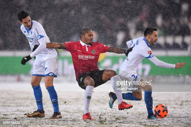 Benjamin Hubner of 1899 Hoffenheim Charlison Benschop of Hannover 96 and Lukas Rupp of 1899 Hoffenheim battle for the ball during the Bundesliga...