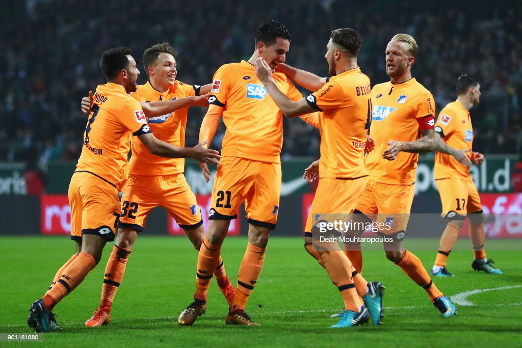 Benjamin Hubner #21 of TSG 1899 Hoffenheim celebrates scoring his teams first goal of the game with team mates during the Bundesliga match between SV Werder Bremen and TSG 1899 Hoffenheim at Weserstadion on January 13, 2018 in Bremen, Germany.