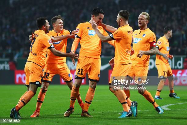 Benjamin Hubner of TSG 1899 Hoffenheim celebrates scoring his teams first goal of the game with team mates during the Bundesliga match between SV...