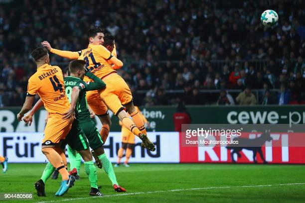 Benjamin Hubner of TSG 1899 Hoffenheim heads the ball from the corner to score the first goal of the game during the Bundesliga match between SV...