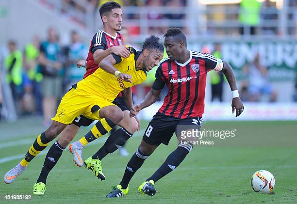 Benjamin Huebner and Roger de Oliveira Bernardo of FC Ingolstadt challenge PierreEmerick Aubameyang of Borussia Dortmund during the Bundesliga match...
