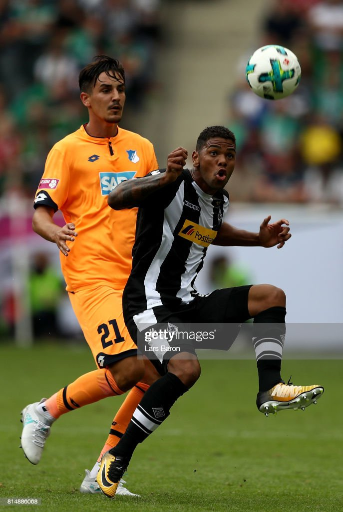 Benjamin Huebner challenges Kwame Yeboah of Moenchengladbach during the Telekom Cup 2017 3rd place match between Borussia Moenchengladbach and TSG Hoffenheim at Borussia Park on July 15, 2017 in Moenchengladbach, Germany.