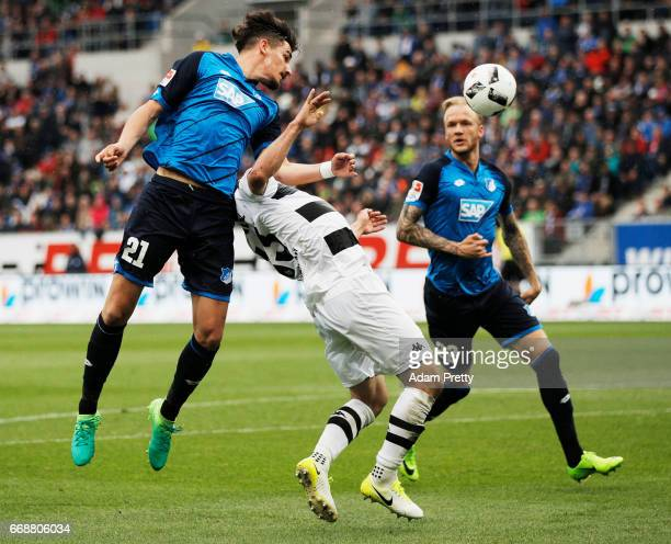 Benjamin Huebner of 1899 Hoffenheim challenges Alvaro Dominguez of Borussia Moenchengladbach during the Bundesliga match between TSG 1899 Hoffenheim...