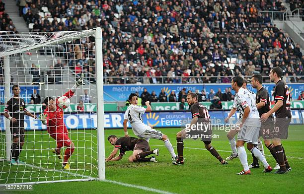 Benjamin Huebner of Aalen scores the winning goal during the Second Bundesliga match between FC St Pauli and VfR Aalen at Millerntor Stadium on...