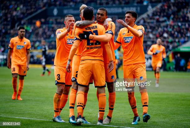 Benjamin Huebner of Hoffenheim celebrates with team mates after scoring his teams first goal during the Bundesliga match between Borussia...
