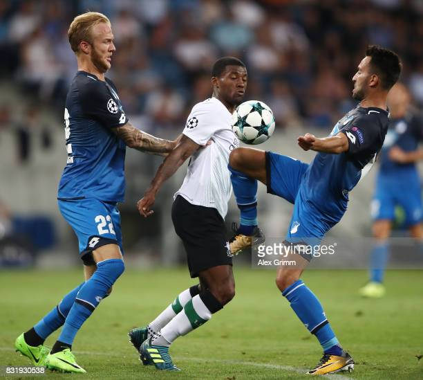 Benjamin Huebner of Hoffenheim Georginio Wijnaldum of Liverpool and Lukas Rupp of Hoffenheim during the UEFA Champions League Qualifying PlayOffs...