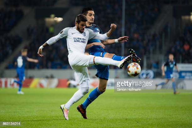 Benjamin Huebner of Hoffenheim is tackled by Junior Caicara of Istanbul during the UEFA Europa League group C match between 1899 Hoffenheim and...