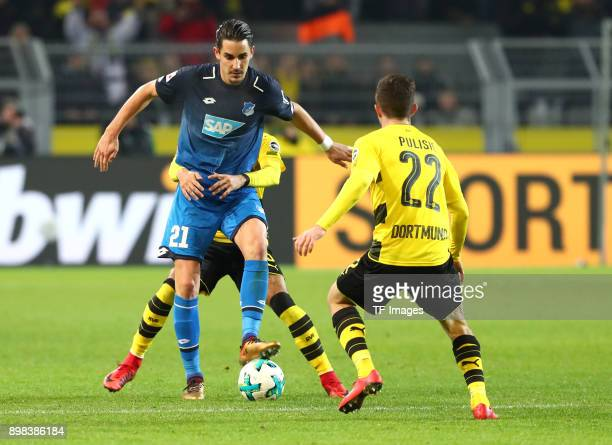 Benjamin Huebner of Hoffenheim Jeremy Toljan of Dortmund and Christian Pulisic of Dortmund battle for the ball during the Bundesliga match between...