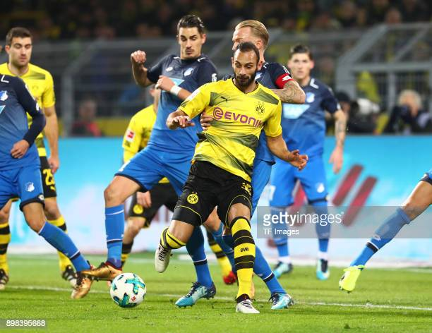 Benjamin Huebner of Hoffenheim Oemer Toprak of Dortmund and Kevin Vogt of Hoffenheim battle for the ball during the Bundesliga match between Borussia...