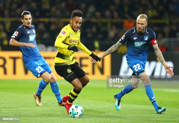 Benjamin Huebner of Hoffenheim PierreEmerick Aubameyang of Dortmund and Kevin Vogt of Hoffenheim battle for the ball during the Bundesliga match...