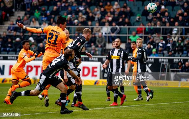 Benjamin Huebner of Hoffenheim scores his teams first goal during the Bundesliga match between Borussia Moenchengladbach and TSG 1899 Hoffenheim at...