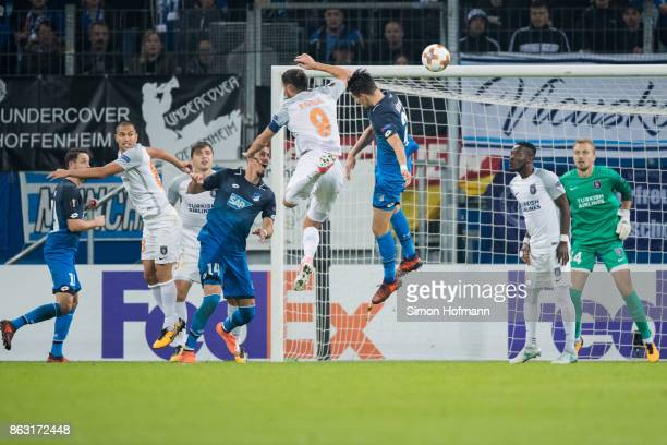 Benjamin Huebner of Hoffenheim scores his team's first goal past goalkeeper Mert Guenokiu of Istanbul during the UEFA Europa League group C match...
