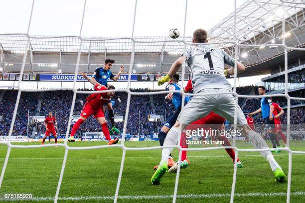 Benjamin Huebner of Hoffenheim scores his team's first goal with a header past Lukas Hradecky of Frankfurt during the Bundesliga match between TSG...
