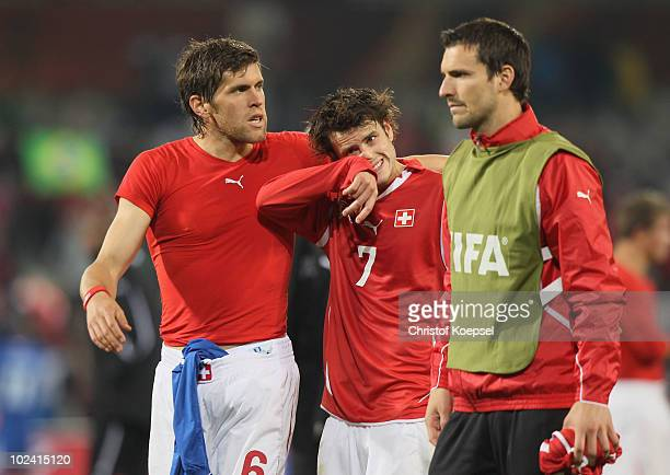 Benjamin Huggel of Switzerland consoles dejected Tranquillo Barnetta after a goalless draw and elimination from the tournament during the 2010 FIFA...