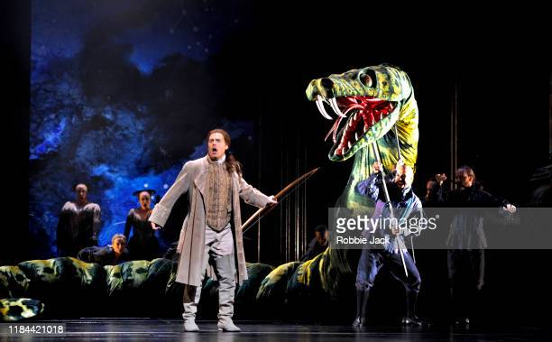 Benjamin Hulett as Tamino with artists of the company in The Royal Opera's Production of Wolfgang Amadeus Mozart's The Magic Flute directed by David...