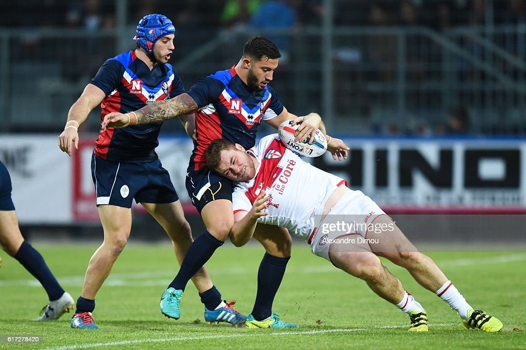 Benjamin Jullien and Romain Navarette of France and Tom Burgess of England during the rugby union test match between France and England on October 22, 2016 in Avignon, France.