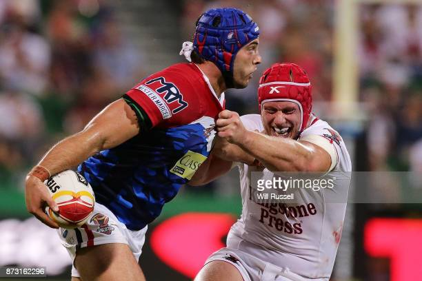 Benjamin Jullien of France is tackled by Chris Hill of England during the 2017 Rugby League World Cup match between England and France at nib Stadium...