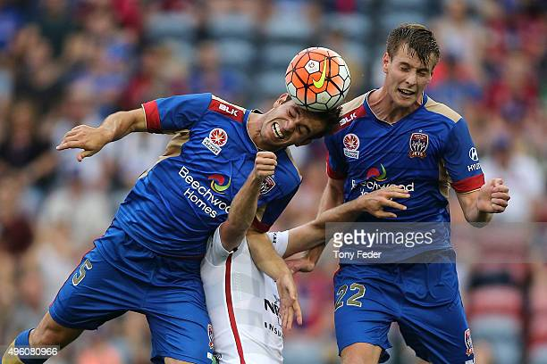 Benjamin Kantarovski and Lachlan Jackson of the Jets contest a header with Mitch Nichols of the Wanderers during the round five ALeague match between...