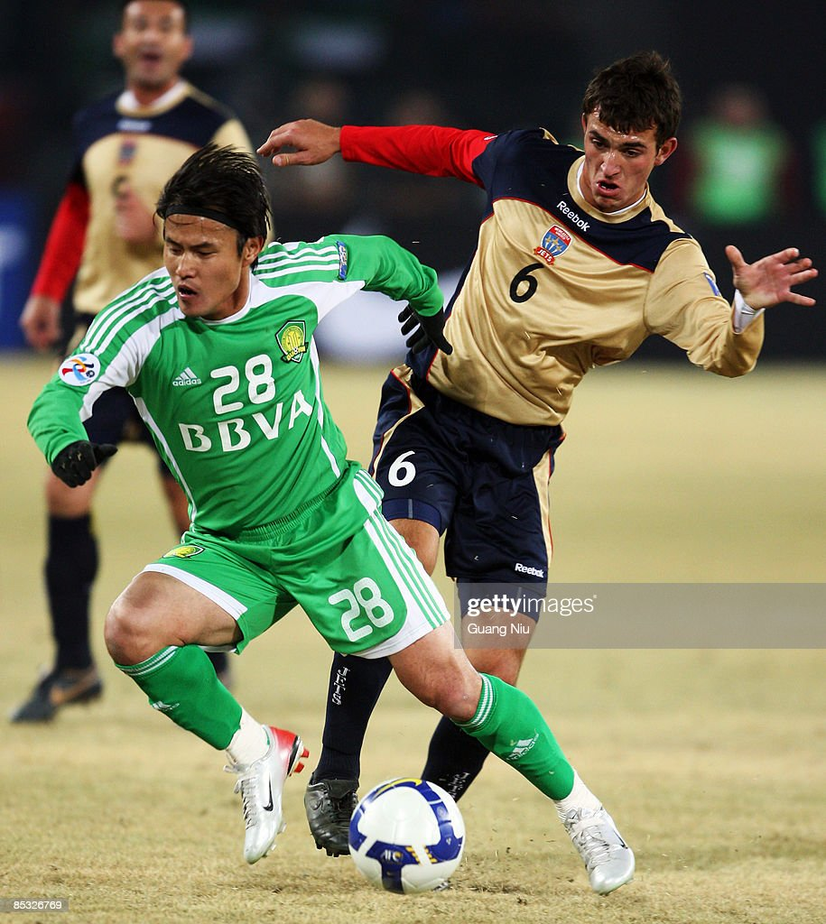 Benjamin Kantarovski (R) of Newcastle Jets and Guo Hui of Beijing Guoan fight for a ball during the AFC Champions League Group E match between Beijing Guoan and the Newcastle Jets at Beijing Worker's Stadium on March 10, 2009 in Beijing, China.