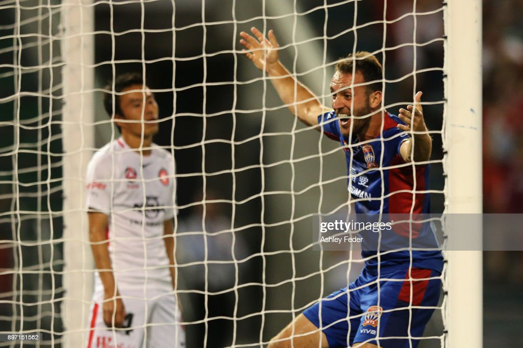 Benjamin Kantarovski of the Jets celebrates his goal with Jumpei Kusukami of the Wanderers looking dejected in frame during the round 12 A-League match between the Newcastle Jets and the Western Sydney Wanderers at McDonald Jones Stadium on December 22, 2017 in Newcastle, Australia.
