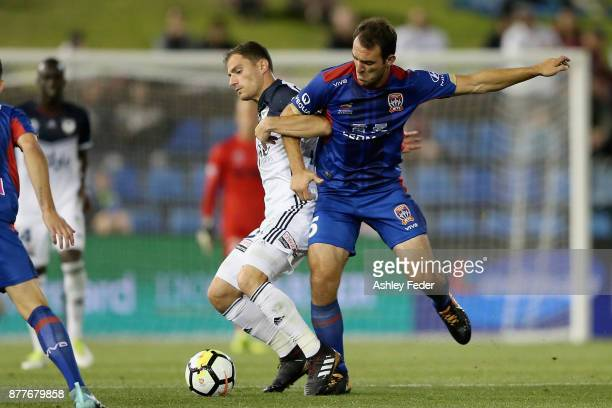 Benjamin Kantarovski of the Jets contests the ball against Leigh Broxham of the Victory during the round eight ALeague match between the Newcastle...
