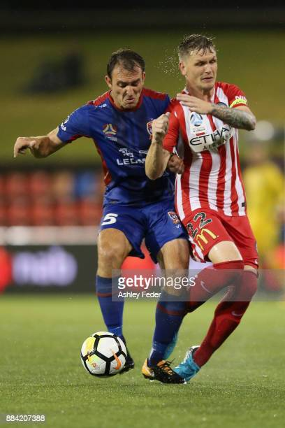 Benjamin Kantarovski of the Jets contests the ball against Michael Jakobson of Melbourne City during the round nine ALeague match between the...