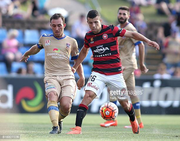 Benjamin Kantarovski of the Jets contests the ball with Joshua Sotirio of the Wanderers during the round 23 ALeague match between the Newcastle Jets...