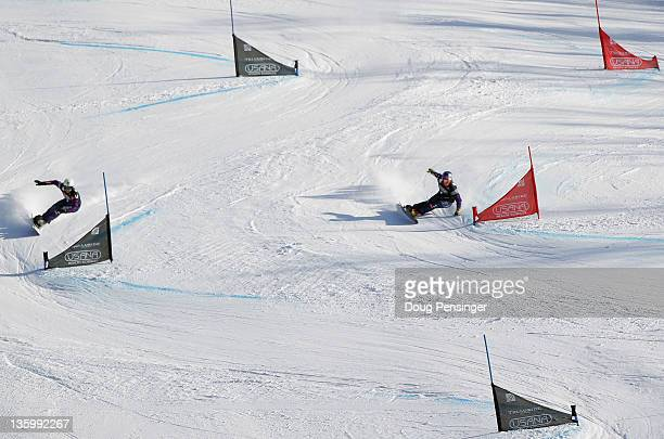 Benjamin Karl of Austria beats Andreas Prommegger of Austria in the finals of the men's parallel giant slalom at the LG Snowboard FIS World Cup on...