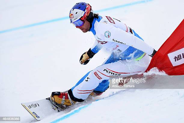 Benjamin Karl of Austria competes in the Men's Parallel Slalom on the day two during FIS Snowboard World Cup Alpine Snowboard on March 1 2015 in...