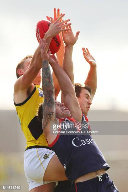Benjamin Kennedy of the Casey Demons competes in the air during the VFL Semi Final match between Casey and Richmond at Fortburn Stadium on September...