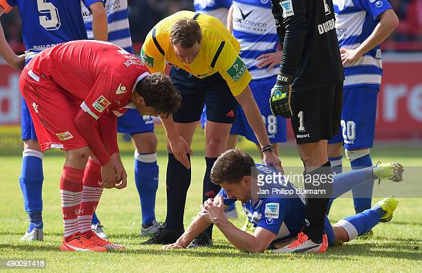 Benjamin Kessel of 1 FC Union Berlin referee Soeren Storks and Dustin Bomheuer of MSV Duisburg during the game between Union Berlin and MSV Duisburg...