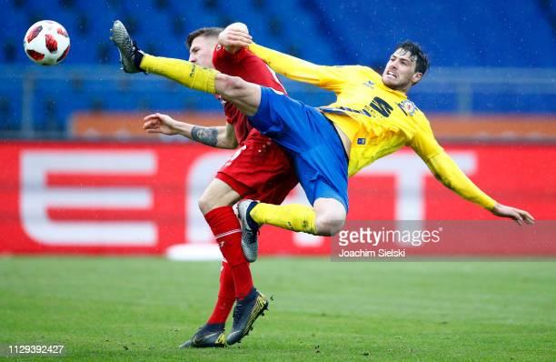 Benjamin Kessel of Braunschweig challenges Janik Bachmann of Wuerzburg during the 3 Liga match between Eintracht Braunschweig and FC Wuerzburger...