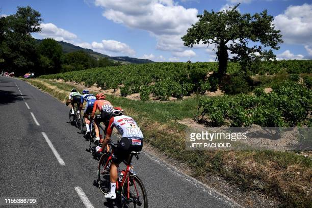 Benjamin King, Netherlands' Niki Terpstra, Belgium's Thomas De Gendt and Italy's Alessandro De Marchi ride in a breakaway during the eighth stage of...