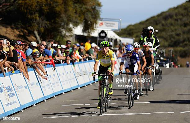 Benjamin King of the United States riding for Cannondale Pro Cycling Team in the yellow jersey crosses the finish line during Stage 3 of the Amgen...