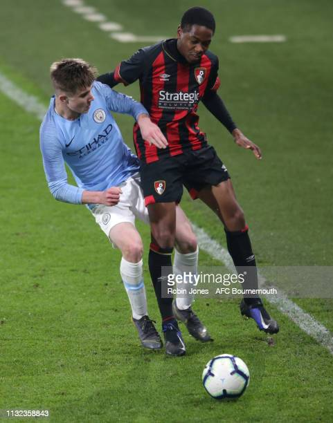 Benjamin Knight of Manchester City and Nathan MoriahWelsh of Bournemouth compete for the ball during the FA Youth Cup match between AFC Bournemouth...