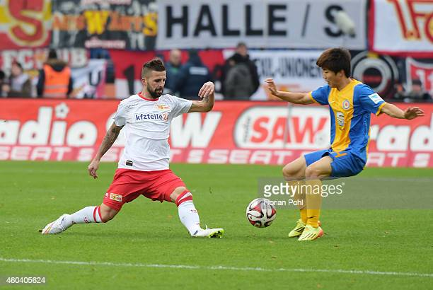 Benjamin Koehler of 1 FC Union Berlin and SeungWoo Ryu of Eintracht Braunschweig in action during the game between Eintracht Braunschweig and Union...
