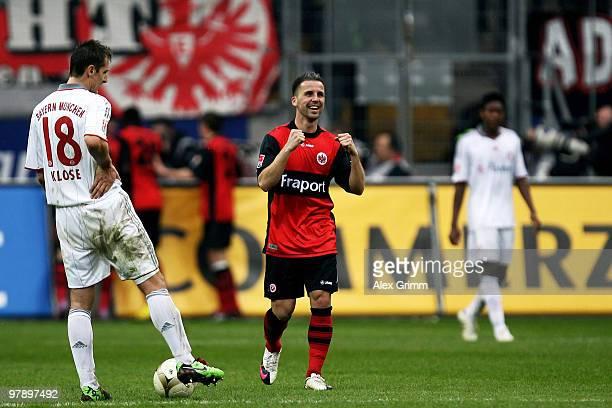 Benjamin Koehler of Frankfurt celebrates as Miroslav Klose of Muenchen looks dejected during the Bundesliga match between Eintracht Frankfurt and...