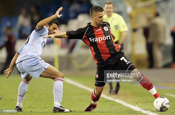 Benjamin Koehler of Frankfurt competes with Antonio Guayre of Vigo during the UEFA Cup group H match between Celta Vigo and Eintracht Frankfurt at...