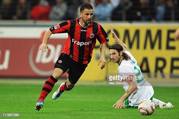 Benjamin Koehler of Frankfurt eludes Torsten Frings of Bremen during the Bundesliga match between Eintracht Frankfurt and SV Werder Bremen at...